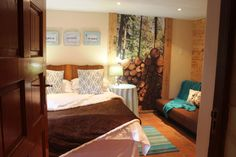 Beautiful bedrooms. Forest wallpaper. Log cabin room ideas. Relax with a glass of red wine at 3@Marion Guesthouse.
