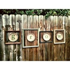 I made these fence decorations because I couldn't find wood letters in a font I liked. DIY: Discs are terra cotta saucers. Cut out letter