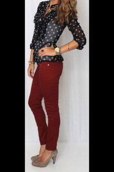 Burgundy pants with navy top.