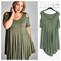 Olive top has short sleeves, open shoulders and a scoop neck. Princess seams in front and back flare to give the top a nice swing. Asymmetrical hems dip in back and front.