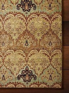 Hand-knotted in an authentic heirloom weave for durability and beauty, the Sumachi Knotted Area Rug tells s tory of rich tradition and offers plush comfort underfoot in any room.