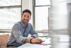 View top-quality stock photos of Office Life A Man Sitting At A Desk Using A Computer Looking At The Camera. Find premium, high-resolution stock photography at Getty Images. Business Portrait, Corporate Portrait, Business Headshots, Corporate Headshots, Business Photos, Business Man Photography, Portrait Photography Men, Corporate Photography, Photography Poses For Men