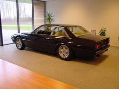 Daft Punk's Ferrari 412 in the show room. Drive whilst wearing a Tom Ford suit.