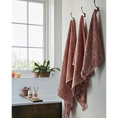 Blending deep pinks with creams and a glimmer of gold, revitalise your bathtime with our Simplicity towel range.