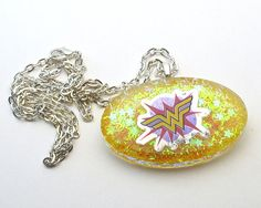 These beautiful resin pendants are a must have for any fan! Each pendant features stickers and embellishments cast crystal clear resin on a sparkling