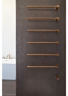 #Vola T39 Heated Towel Rail in brushed copper Sophisticated, contemporary and beautifully streamline. It's modernist approach to towel rail design places this product at the very frontier of #architecture endeavours. The co-existance between the signature brand and its cutting edge manufacturing brings new life to the heated towel rail realm. The Vola T39 is a dynamic heated towel rail with its dual choice of hydro or electrically #heatedtowelrail to suit your #bathroom #brushedcopper