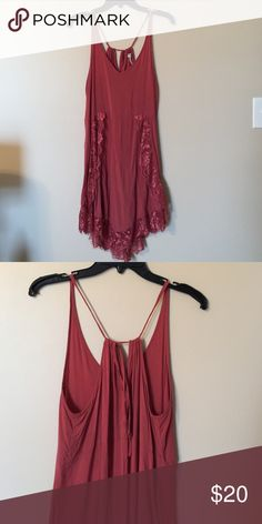 Free People Slip Free People Sip worn once; great condition; somewhat of a deep wine color; Lace detail on front and tie back; fits TTS and the tie back allows for size adjustment Free People Intimates & Sleepwear Chemises & Slips