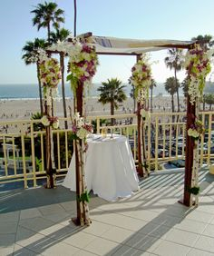 Natural #birch #chuppah draped with flowers - #purplehydrangeas, #roses and #orchids