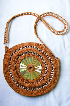 Made with CD, pop tops and yarn. Great recycled purse (in a different colored yarn, this could be really cute)