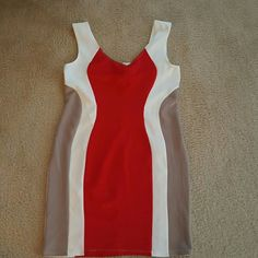 "Colorblock fitted dress XL new Dress is sized XL, but fits more like a large. It is fitted, hugs the curves. Measures across front chest 17"" and hips 19""  length from neckline is 26""  new never worn hot gal Dresses Mini"