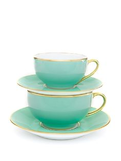 Mint green tea and breakfast cups with gold rims and handles.
