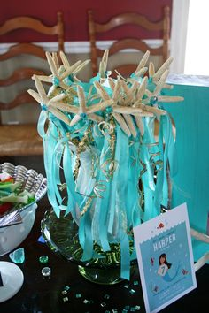 DIY mermaid wands for favors: dowels painted turquoise, starfish glued to end, ribbons tied on  {Stephanie Howell}