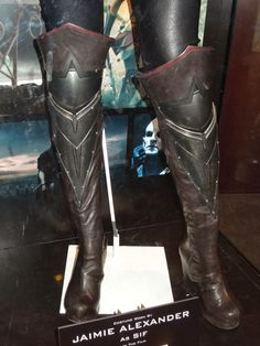 Front shot of boots, with armor accents and leather over-the-knee additions. Dark brown platform wedges with center seam, side zip (nearly invisible).