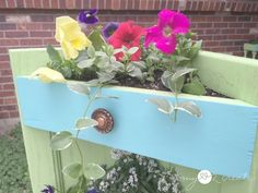 Make a beautiful DIY Corner Planter from your left over cabinet doors! This corner planter looks like a set of faux drawers, perfect for your porch.