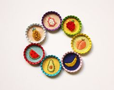 Get yourself a fruit pin and be delicious this summer!  Details:  -Those juicy fruits embroidered by hand onto cotton fabric. -Bottlecaps are 1