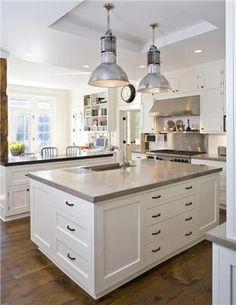 white kitchen, concrete counters, schoolhouse lights