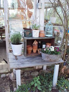 potting table-oh i love the use of the old gate.  Look at that pretty hinge back left.