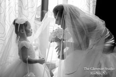 www.glenmarstudio.com The bride and her flower girl. #bride #flowergirl #bouquet #flowers #bridalparty #veil #weddingdress #bridalfashion #flowergirldress #wedding #brideandgroom #couple #love #ido #marriage #mrandmrs #newlyweds #justmarried #ceremony #reception #celebration #weddingday #theknot #weddingwire #weddingphotography #photojournalism #weddingphotographer #photography #photographystudio #glenmarstudio