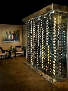 Custom glass and metal wine cellar recessed into an existing wall in the clients dining room.