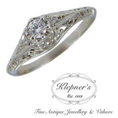 Classic Bespoke Vintage Inspired Filigree Engagement Ring. Price shown is based on custom making this classic bespoke Art Deco inspired filigree engagement ring in 18ct white gold, set with one approximately 0.11ct round brilliant cut diamond, G in colour, VS1 in clarity & an additional two round brilliant diamonds totalling approximately 0.10ct. Visit us at www.klepners.com.au