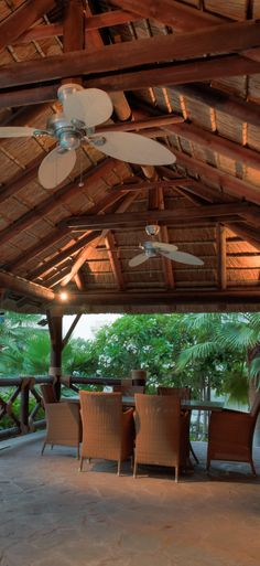Outdoor area with thatched roof & seating area! Perfect for outdoor dining!