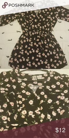Beautiful floral summer dress Floral dress with button accents on the top, and an elastic cinched waist. Length falls a few inches above the knee Mimi Chica Dresses Mini