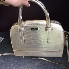 Kate Spade Purse Kate Spade purse. Don't know the exact style name. It's a Goldish color. Used once for about 5 days. It's a very cute bag! kate spade Bags Shoulder Bags