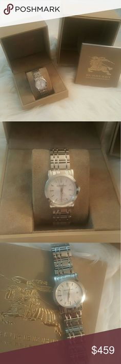 NIB * Burberry Women's 34 MM Watch* NIB * Burberry Swiss Stainless Steel Women's Watch*  Stainless Steel Link Bracelet with etched check pattern and deployant buckle* Round Case, 34 mm* Swiss Quartz Movement * Feel free to Inquire and ask Questions * Reasonable offers accepted * Bundle & Save* Burberry Accessories Watches