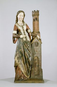 Saint Barbara: The virgin martyr stands by her usual atttibute - the tower with three windows symbolizing her belief in the Trinity, ca. 1450-1500, Flanders.
