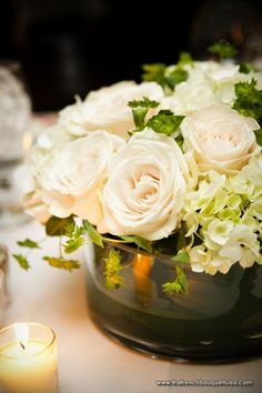 Low Centerpieces of Cream Roses, Hydrangea and Dainty Ivy