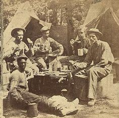 Union Army soldiers eating a camp dinner.