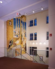 A view of the mural on the wall of the stairs leading up to the Upper Lobby- The Palace Theatre Stamford
