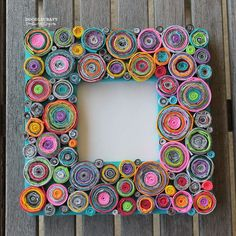 """Upcycled Rolled Paper Frame!This frame is visually stunning with lots of texture and pops of color!However...it's menace runs deeper.It was the most tedious and time consuming project I've ever wrangled my kids into doing.It all started like this. I had been planning this craft for a while...and my husband was out of town,so it seemed like a good time to catch up on projects.My nearly 12 year old son said """"hey mom, can I play Diablo?""""and I said """"Yes, but help me with this proje..."""