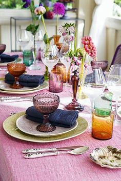 Love this colorful tablescape with pink tablecloth, denim napkins and colorful glassware