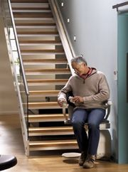 Dolphin Stairlifts UK -- The Straight and Curved Stairlift Specialists. Website for Surrey HQ.