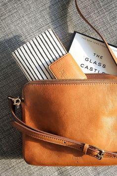 Midweek essentials—Sydney crossbody and striped tab clutch—courtesy of…