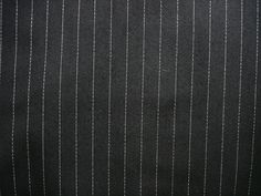 "Black/White Pinstripe - Sew Much Fabric You can get two trends in one fabric-the black/white trend and menswear.  This fabric is light enough to wear now and later.  The white pinstripe is 1/16"" wide and spaced 1/2"" apart.  Perfect for boxy jackets, slouchy pants, vest and pencil skirts."
