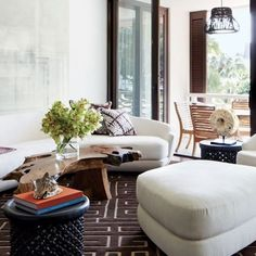LIVING AREA An Auguste Garufi mixed-media work dominates one wall of the living area; Tsao designed the sofa, chair, ottoman, and carpet, th...