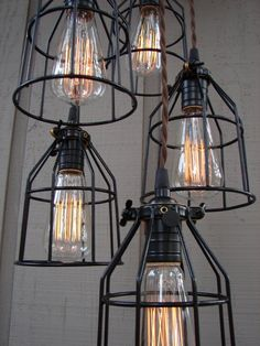 (̏◕◊◕)̋ neat old industrial lights... i have to get me some of these Edison bulbs!