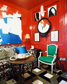 Living Room Red Photo - A floral couch and a green armchair paired with a round wooden table