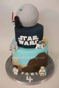 Star Wars Lego birthday cake, with handmade Star Wars logo, Death Star, Millenium Falcon, Lego Darth Vader, Lego Luke Skywalker, Lego Princess Leia, Lego R2D2 & Lego C3PO