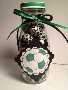 Soccer coach thank you gift made from upcycled Starbucks Frappuccino bottles and filled with soccer ball candy.