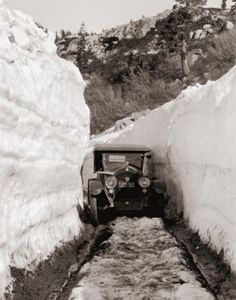 Vintage photograph of car driving through tunnel of snow reproduced by Jim Bell