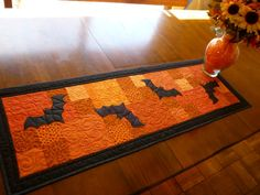 Tablerunner - I'd use a different theme by using applique for something other than Halloween