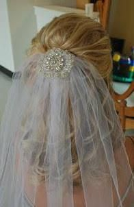 Wedding hair with veil   Sheer so hair shows.  Fastened up high but in the back with a small amount of bling.