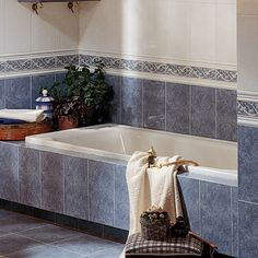 Bretagne Celeste tiles give a classic look in bathrooms, with co-ordinating border tiles to add interest
