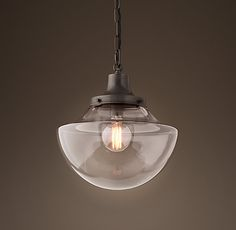 RH's Parisian Architectural Clear Glass Bibliotheque Pendant:Inspired by the City of Light, our replicas of vintage Parisian architectural fixtures highlight their functional, serviceable beauty. Our reproduction, nearly identical to the original design, offers a clear class shade that amplifies the light.