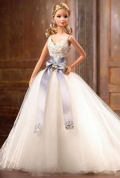 Known for her romantic wedding gowns, Lhuiller's Barbie version is no different. The lace bodice with a tulle skirt is accentuated by an oversized sash.Browse Monique Lhuillier gowns for real bridesPhoto via Barbie Collector Barbie Bridal, Barbie Wedding Dress, Wedding Doll, Barbie Gowns, Barbie Dress, Barbie Clothes, Wedding Gowns, Bridal Gowns, Monique Lhuillier