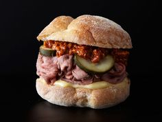 A thick, chunky spread of roasted red peppers blended with walnuts and spice adds earthy funk to an otherwise classic roast beef sandwich.