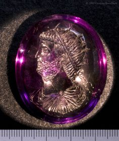 Amethyst intaglio: Portrait of Emperor Gallienus, c.218-268 CE. Roman. Details below document the strongly convex obverse and reverse of the stone, and the highly polished facial features of the emperor. London, British Museum.